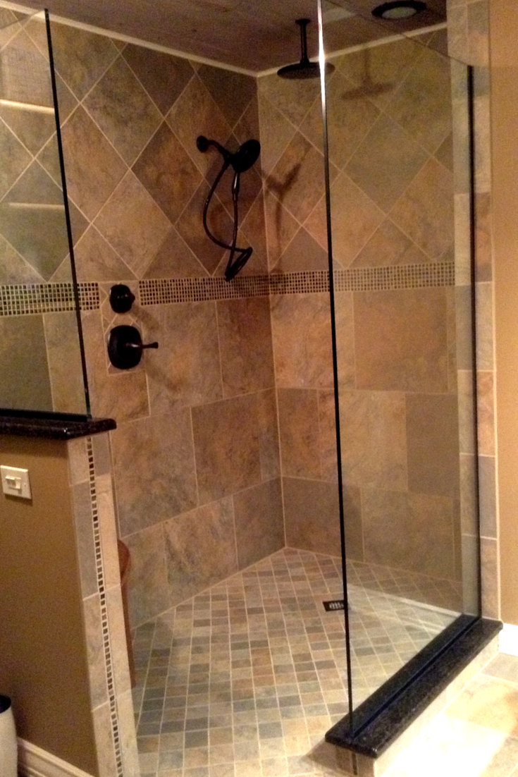 Frameless glass shower wall panels make this shower feel bigger by not dividing spaces| Innovate Building Solutions