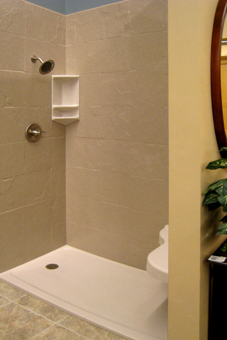 Use solid surface walls and pans to eliminate grout joints
