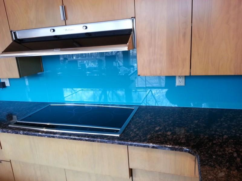 Blue backpainted glass kitchen backsplash