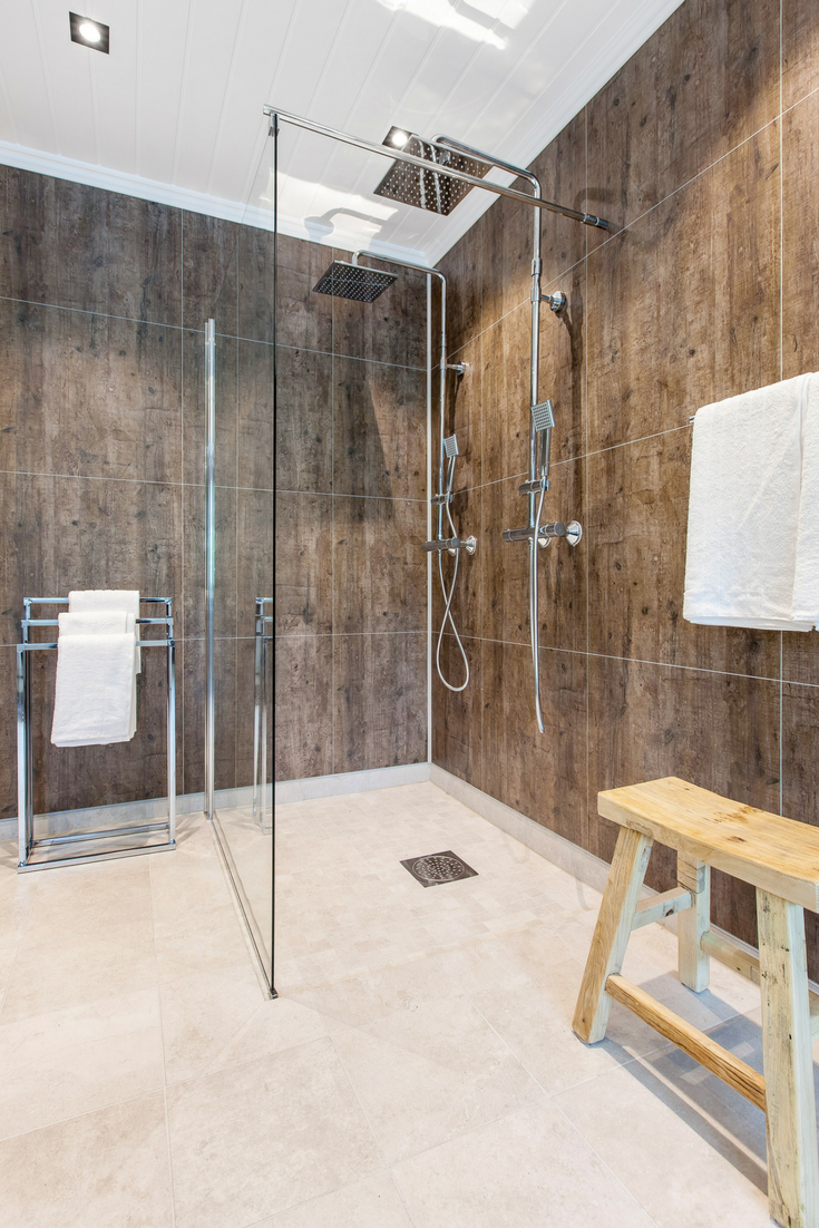Laminated DIY friendly shower wall panels look and feel like they have grout but they are simply high pressure laminate which snaps together | Innovate Building Solutions