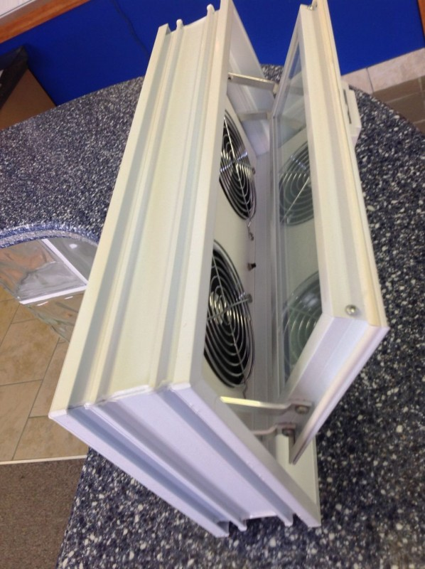 Power air vent for circulation through a glass block basement window