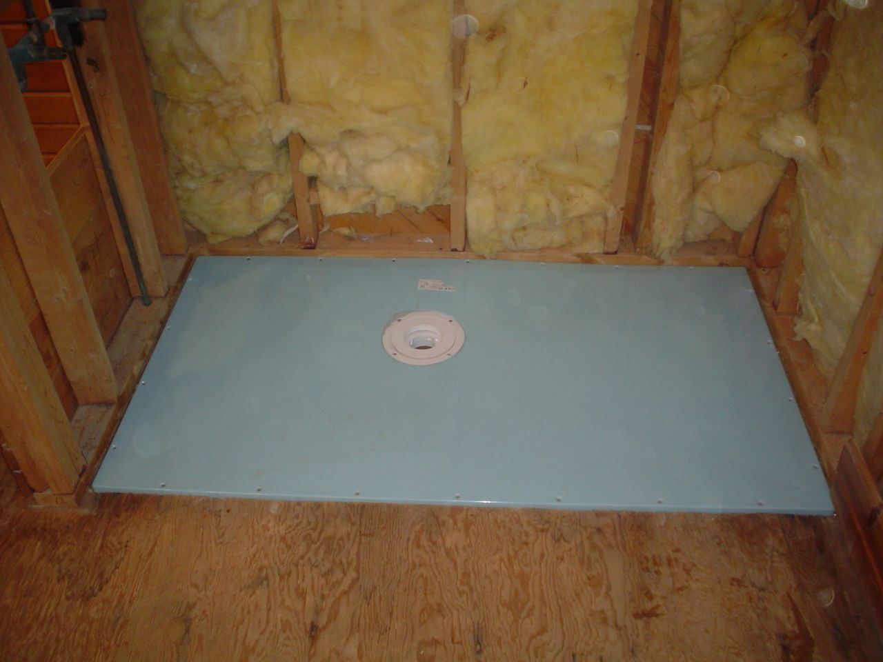 shower base former for a wet room system in a one level walk in shower