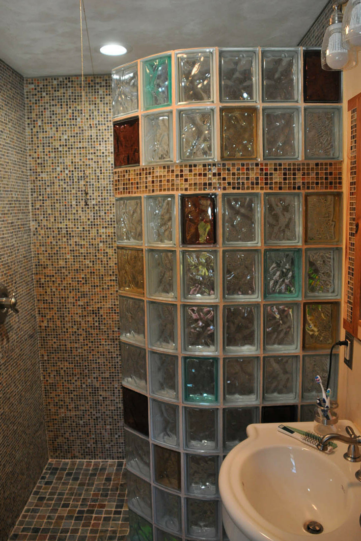 glass block shower built with thinner glass blocks in a curved design