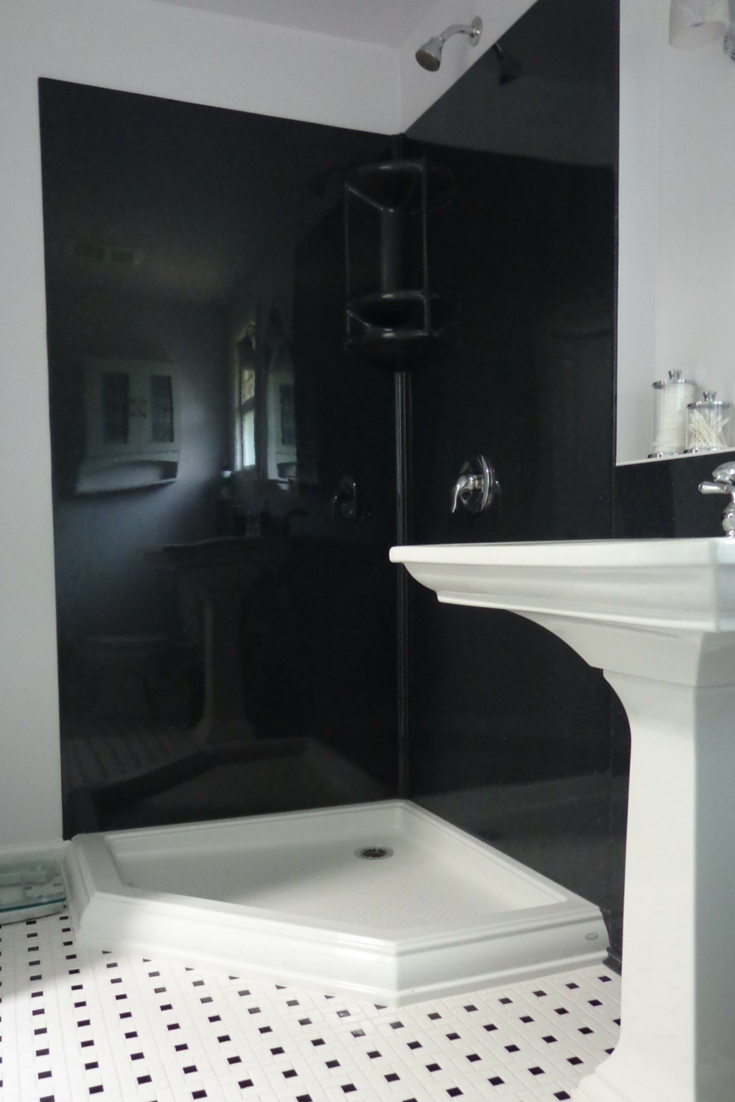 Black colored solid surface stone walls with a NEO angle acrylic shower base