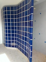 Serpentine shaped colored glass block wall