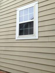 Vinyl framed window in a framed home