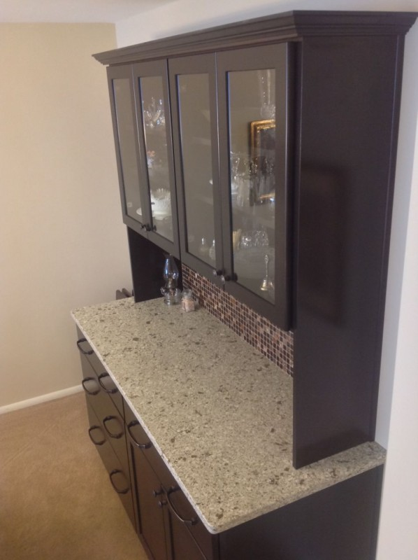 Crown molding and decorative backsplash for a dining room cabinet