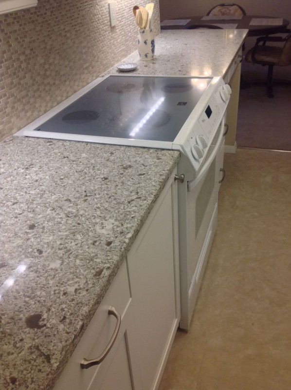 Quartz countertop in a galley style kitchen remodeling in Lakewood Ohio