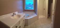 Old before picture single vanity and 1980 style soaking tub
