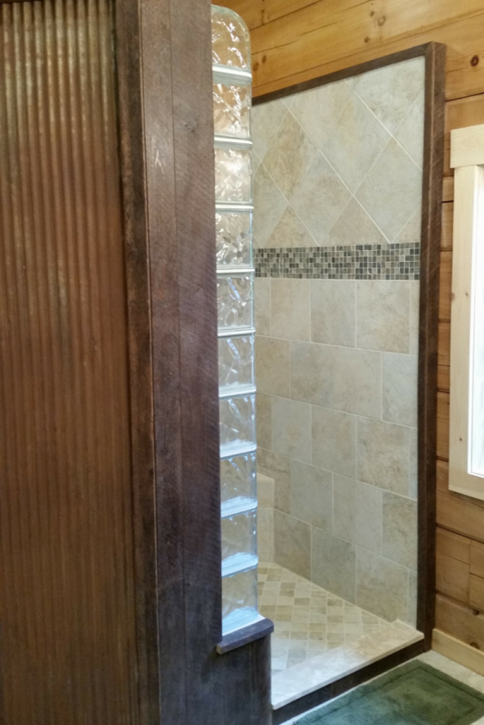 Glass block finished end and curved blocks in a rustic shower
