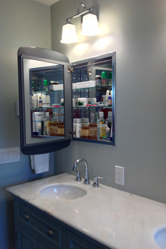 Mirrored medicine cabinets provide storage and function