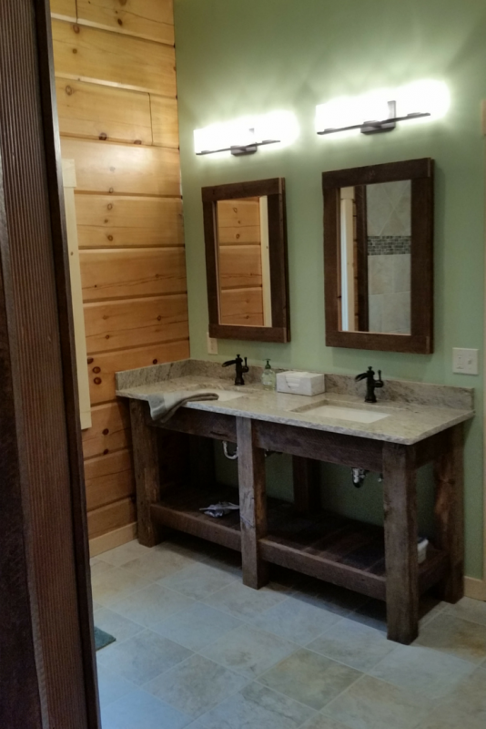 Typhoon green granite countertops with a chiseled edge in a log home