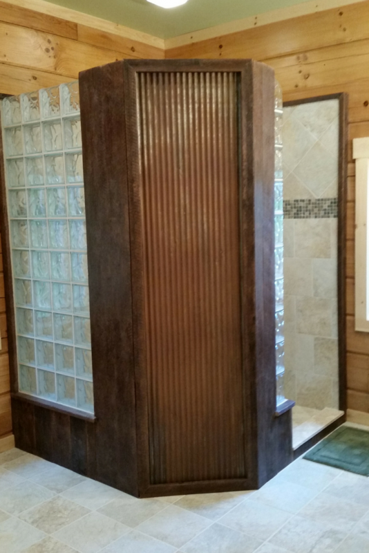 Reclaimed barnwood and galvanized metal used in a log home bathroom in Pennsylvania