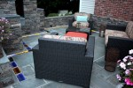How to add impact to a patio with unique hardscaping – colored glass bricks and bluestone