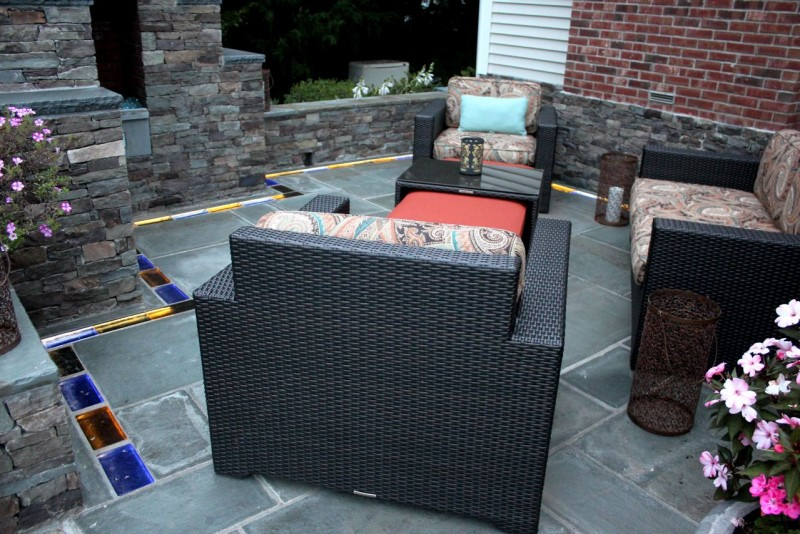 Colored glass brick and bluestone hardscape patio design in Guilford Connecticut