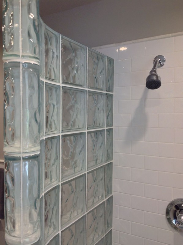 Curved glass block shower wall with white subway tile in columbus ohio