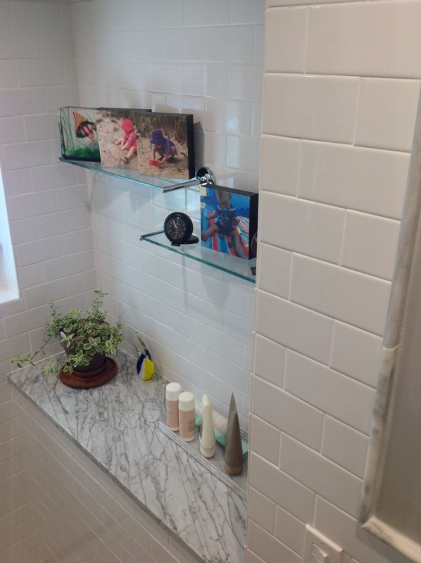 Shower alcove with white subway tile provides a decorative nook for a guest bathroom in Lancaster ohio