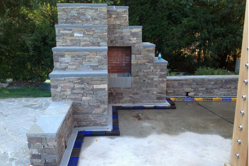 In process picture of colored glass bricks and metal channel LED lighting system of a new patio in Connecticut