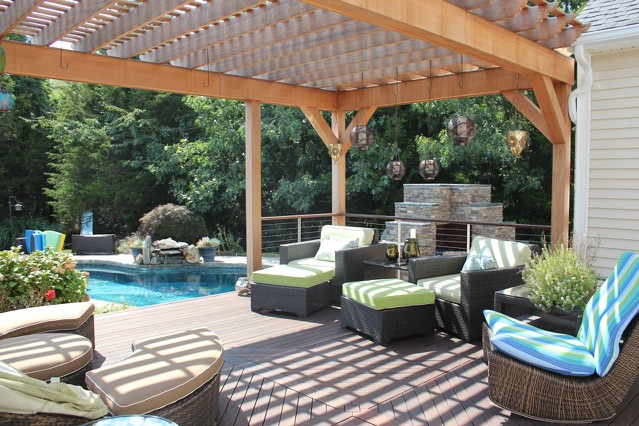 Luxury patio and deck with a pergola in a landscape design in Connecticut