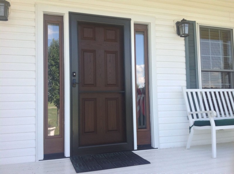 Storm door with a stabilizer bar and six panel fiberglass door