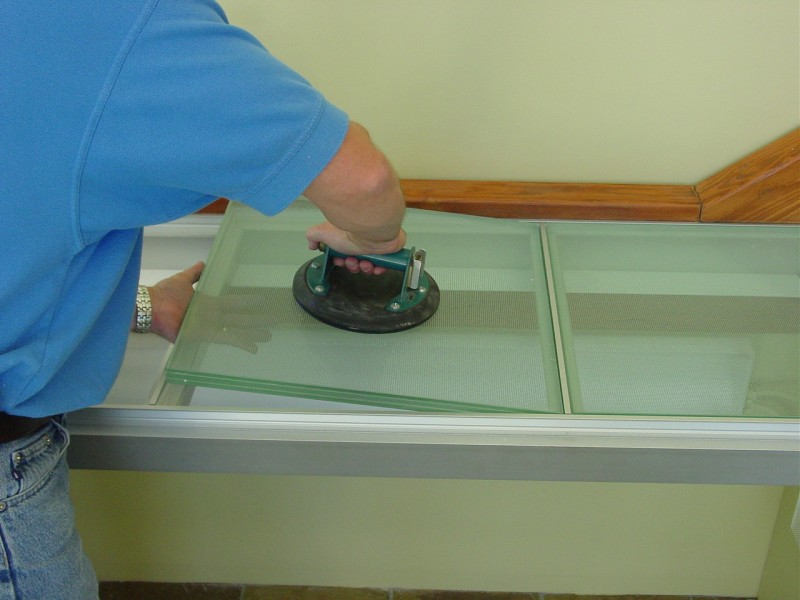 Laminated glass floor panel being installed