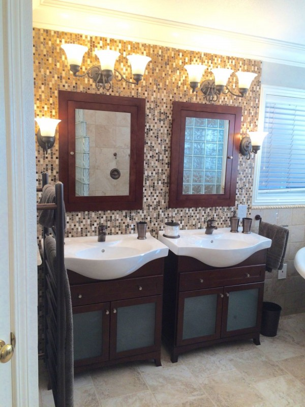 Oil rubbed bronze fixtures with contemporary vanity in Martinez California