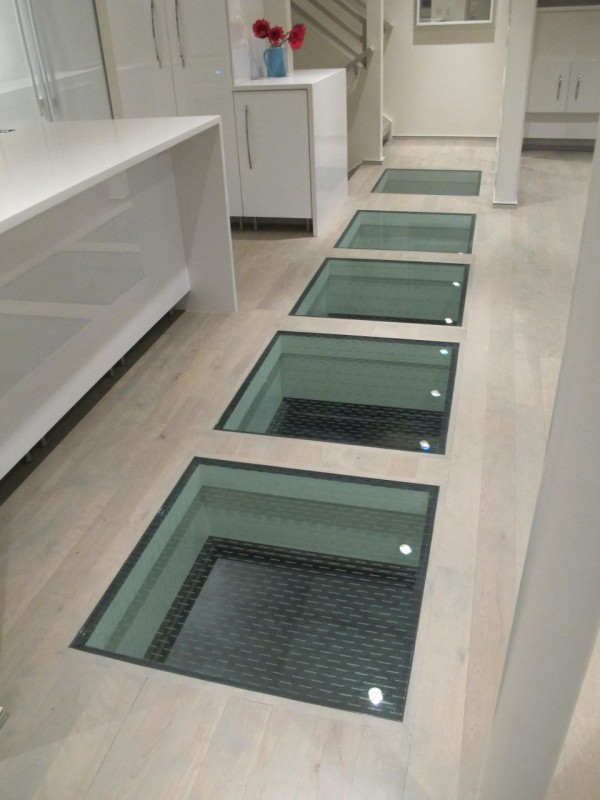 glass panels with a glass frit top surface for traction in a luxury home