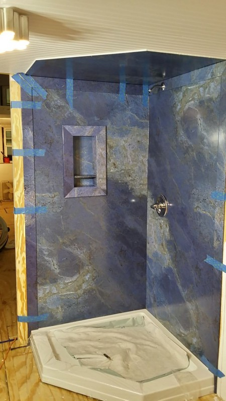Luxury shower panels being installed by a DIY in a tiny home