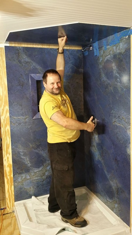 DIY shower panel installation in a tiny home
