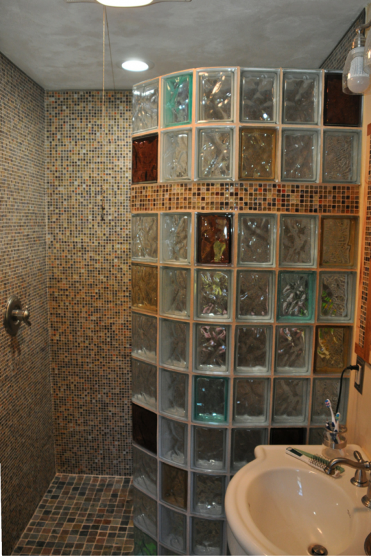 Bath to shower conversion with a colored glass block shower wall