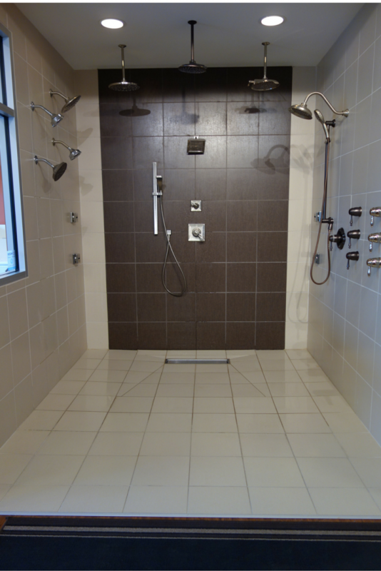 Multiple jets can be used for a spa like experience in a one level shower. The use of the linear drain with larger floor tiles in this one level system is also nice to minimize the number of grout joints in the tile floor. | Innovate Building Solutions