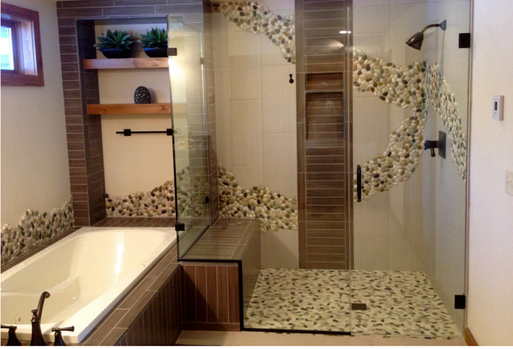 This exotic pebble tile shower design flows into and out of the shower enclosure. It's also nice it incorporates a one level design so it's simple for people of any ages or abilities to get into or out of the shower. | Innovate Building Solutions