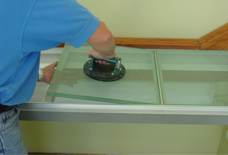 Laminated glass floor sections being installed in an aluminum framework