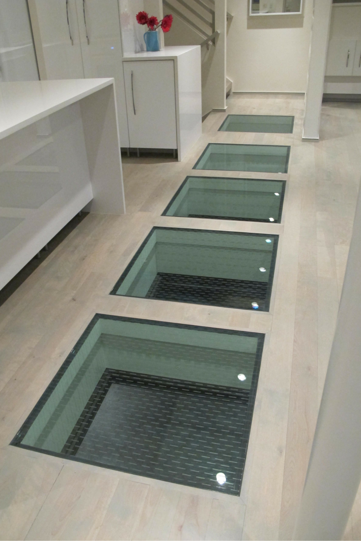 Ceramic frit added to a glass floor for safety when wet