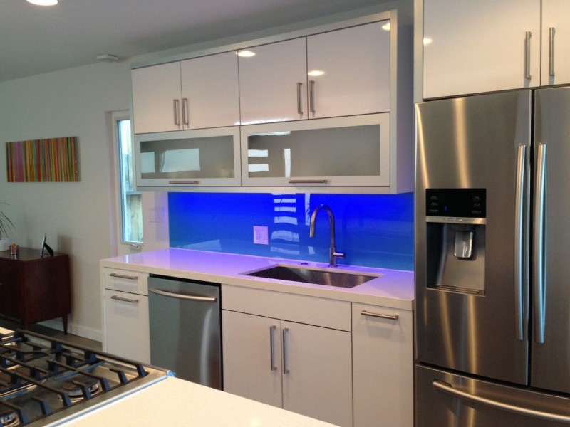 This blue high gloss kitchen backsplash was a DIY project