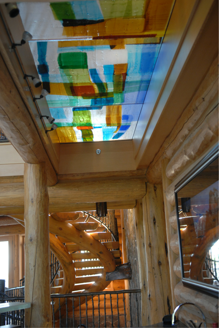 A contemporary art colored cast glass flooring system