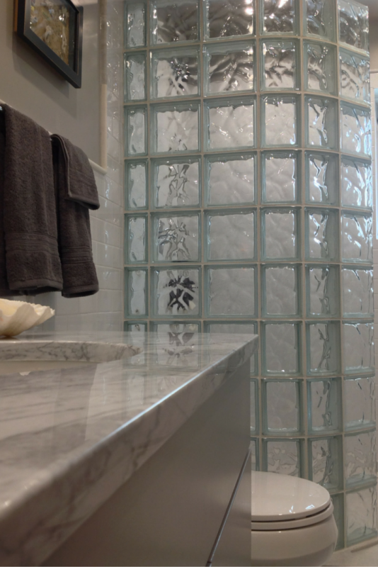 Curved glass block wall for a small tub space