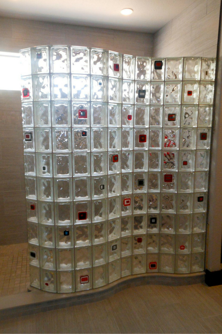 serpentine glass block wall on a ready for tile shower pan with some colored tiles added on | Innovate Building Solutions