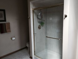 Before picture of Orland Park bathroom before renovation with framed shower enclosure