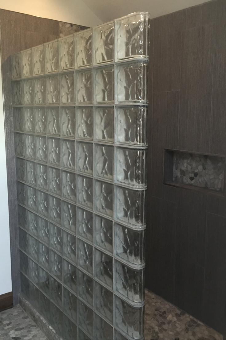 Straight wave pattern glass block shower wall in a zen minimalist bathroom