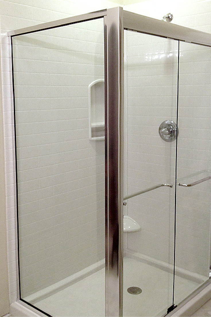 White subway tile shower made using waterproof stone solid surface wall panels