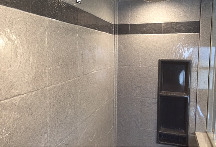 Decorative striped border in a DIY shower wall panel system in a 12 x 12 tile design