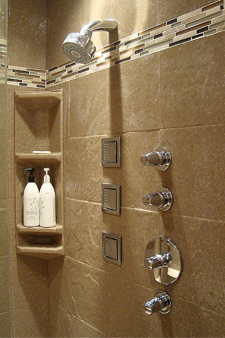 Stone solid surface corner caddies in a 12 x 12 stone tile pattern shower wall panel system