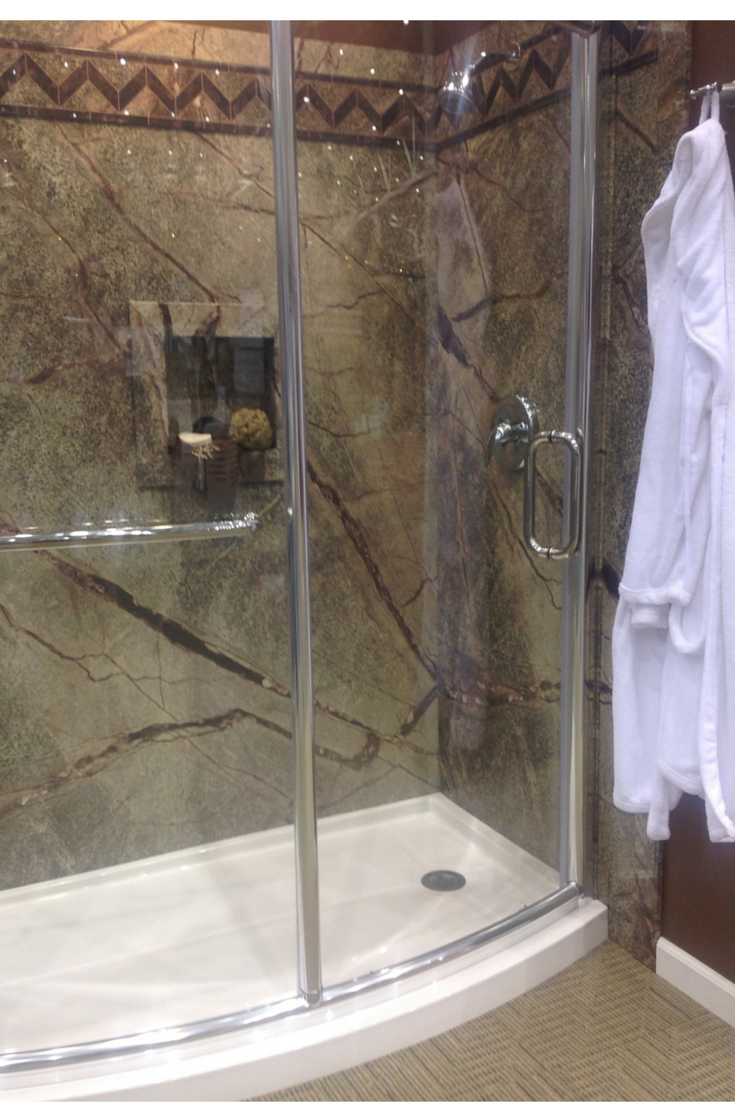 Low priced DIY faux shower wall panel system in a Rainforest pattern