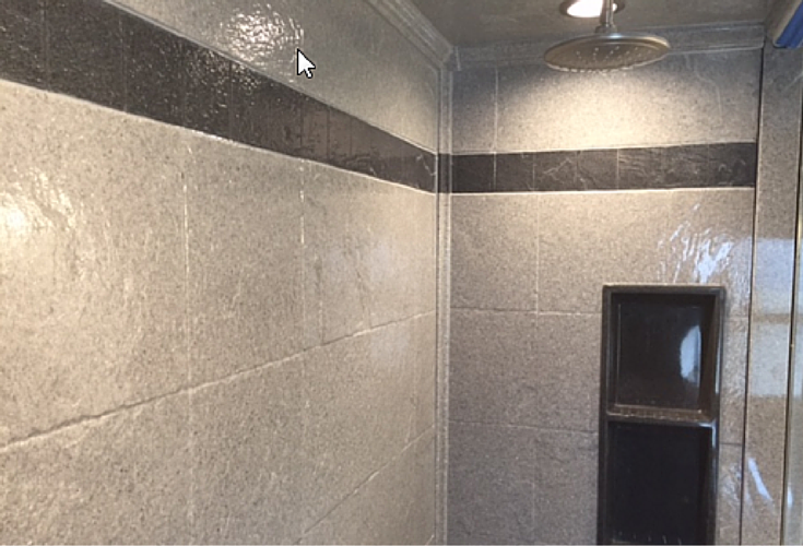 Solid surface stone tile pattern wall panels with a decorative tile trim border