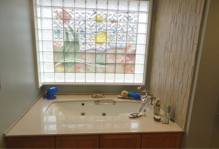 A transfer station tub area for an active adult bathroom