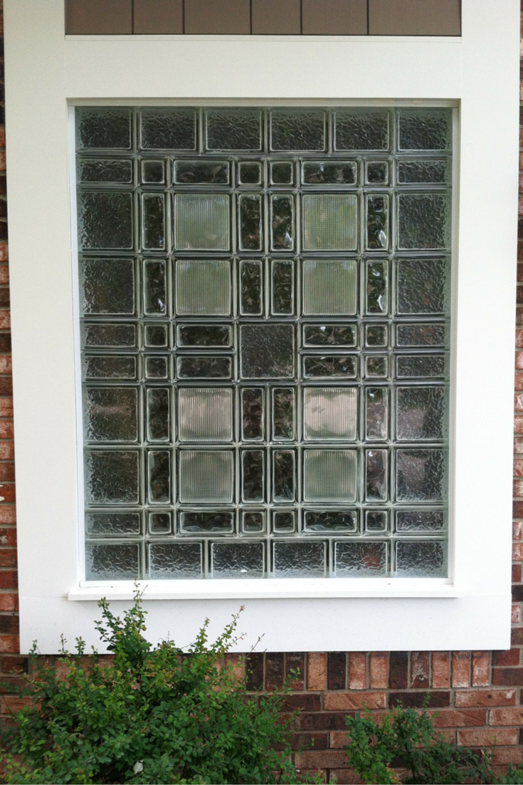 Glass block garage window design using 4 x 8 and 8 x 8 and 4 x 4 blocks with different patterns in Michigan