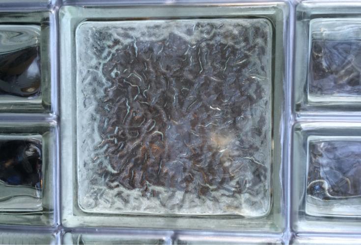 General Electric Metallic Gray Silicone between a Decorative Glass Block Garage window in Michigan