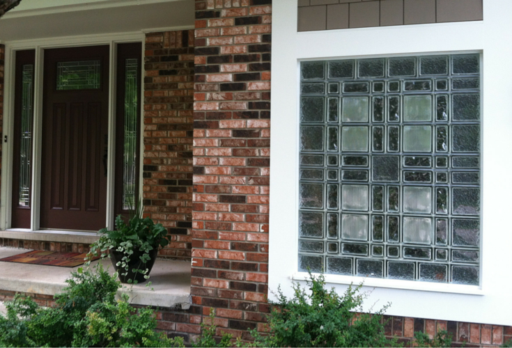 Craftsman style entry door with multi-sized glass block garage window in Michigan