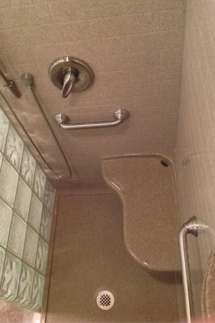 extended 26 x 16 solid surface seat in an accessible shower remodel in akron